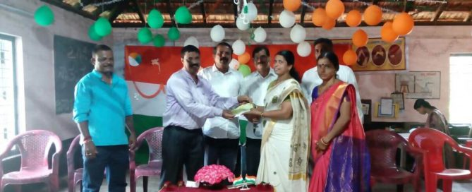 Handing over of cheque towards a teacher's salary to DK ZP HP School Bengre